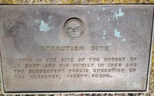 Plaque marking the spot of the Snow family murder and the subsequent hanging of the murderer.