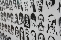 Young people of Christchurch spray-painted their self portrait stencils on a hoarding surrounding one of the many city building sites
